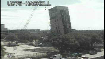 watch: crews try to knock down a 'leaning tower' in dallas, but the tiny wrecking ball can't make a dent