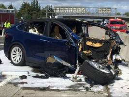 the ntsb said tesla's autopilot and an inattentive driver were likely factors in a fatal 2018 crash (tsla)