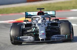 button urges hamilton to extend mercedes contract
