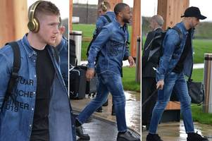 man city don striking double denim outfits for flight to madrid for real clash