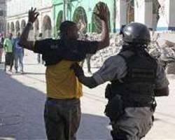 two dead after haitian police attack army hq over work conditions