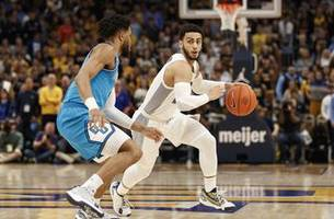 howard pours in 30, marquette beats georgetown 93-69