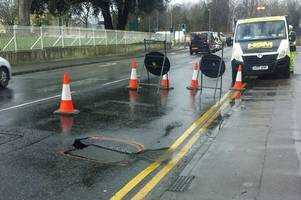 colchester traffic: drivers warned after hole appears in middle of busy mersea road
