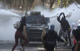 violence resurges in protest-racked chile, nearly 300 arrested