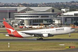 qantas cuts almost a quarter of all flights and says its ceo will stop taking a salary