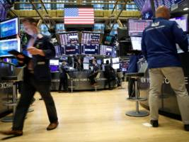 the new york stock exchange is preparing to close its trading floor as the coronavirus sweeps through new york