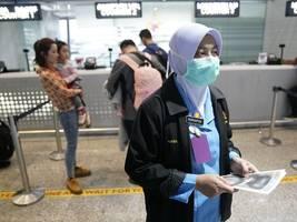 china says coronavirus peak has passed as epicentre logs single-digit new cases