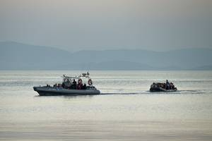tanker with about 190 migrants runs aground on greek island