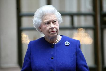 queen elizabeth moves out of palace as aide tests virus positive: report