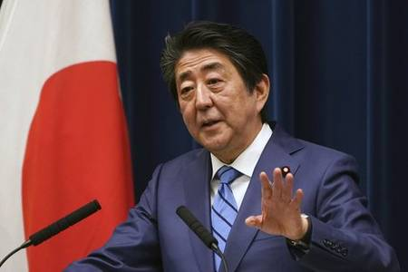 japan pm abe: agreed with ioc's bach on idea of delaying olympics one year