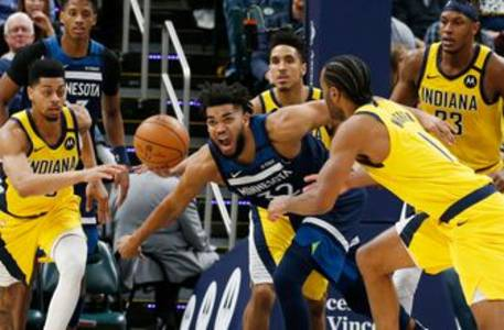 Timberwolves' Towns says mother is in medically induced coma with COVID-19