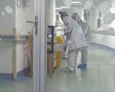 fever checks, hazmat suits: china hospitals take no chances after virus lockdown
