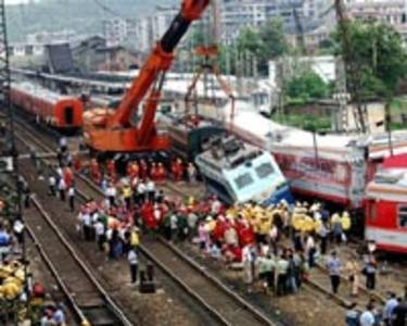 chinese passenger train derailed by landslide debris