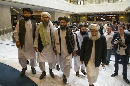 afghan government, taliban hold face-to-face talks for first time