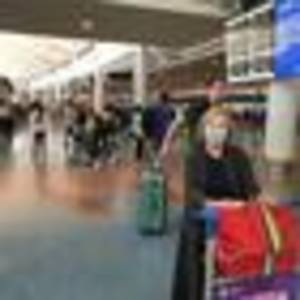 covid 19 coronavirus: overseas travellers relieved to be heading home