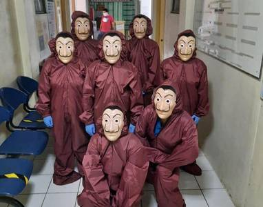 covid-19 cheers: philippines frontliners in 'money heist,' 'power rangers,' 'black panther,' colorful ppes